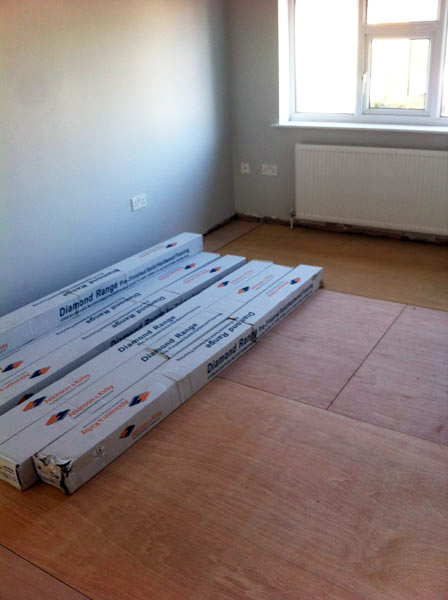 Packs of flooring inside room
