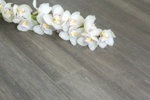 Solid Uniclic Stone Grey Strand Woven 135mm Bamboo Flooring Room Shot with Orchid