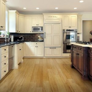 White kitchen with golden bamboo floor