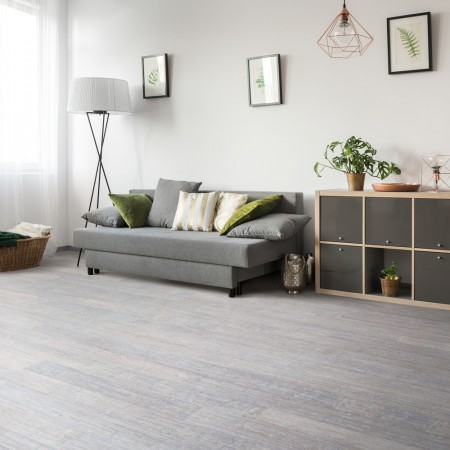 Light grey bamboo floor with sofa and lamp