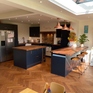Carbonised Parquet Block Bamboo Flooring throughout an open plan Kitchen and Dining area